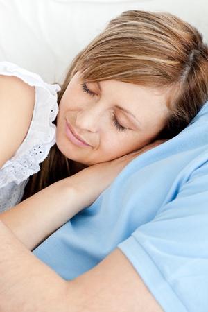 Close-up of a sleeping woman hugging her boyfriend photo