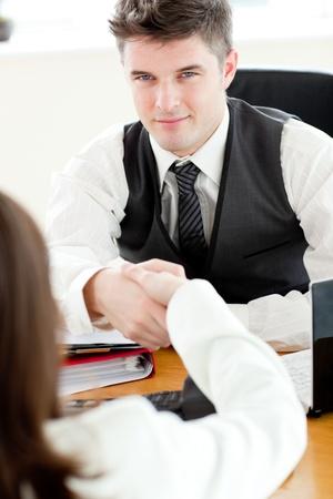 Handsome businessman closing a deal Stock Photo - 10248057