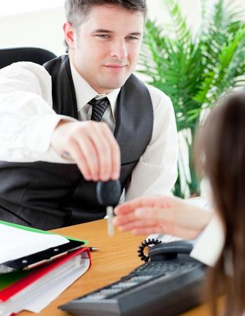 twain: Charming salesman giving car Stock Photo