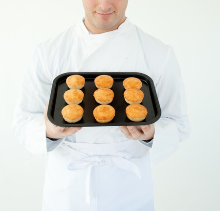 Close-up of a cook holding muffin photo