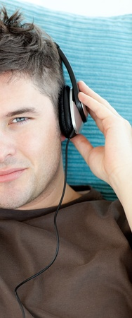 Charming young man listening to music with headphones Stock Photo - 10247918