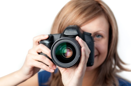 photo shooting: Attractive woman using a camera