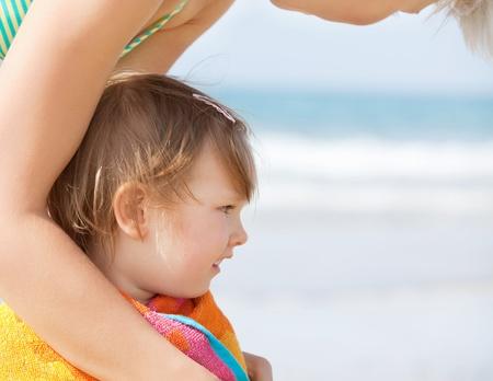 cheerless: A cheerless girl in a towel at the beach