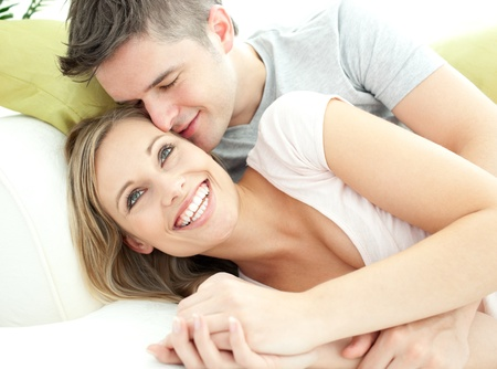 Cute lovers having fun together in the living-room Stock Photo - 10248114