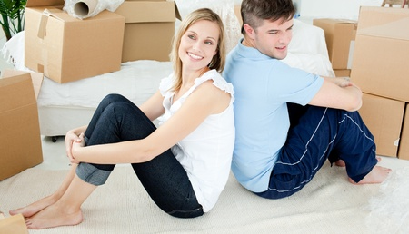 Young couple relaxing after moving Stock Photo - 10248872