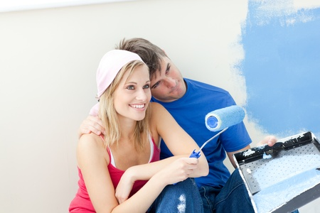 Affectionate couple painting a room photo