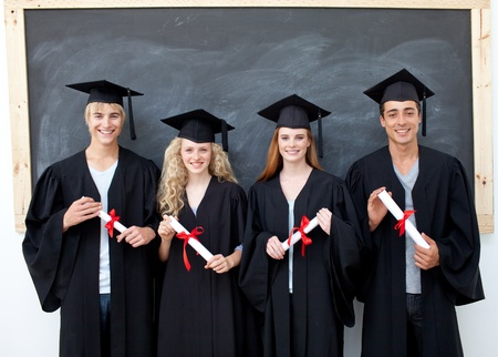 highschool: Group of adolescents celebrating after Graduation