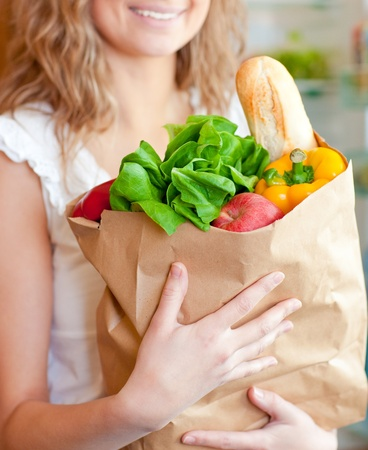 Smiling woman holding a shopping bag  photo