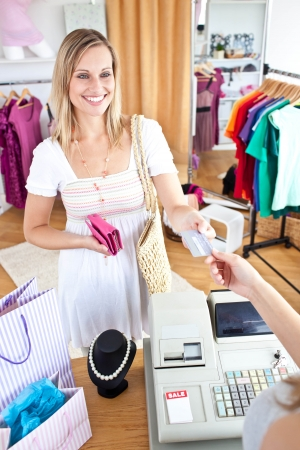 buy: Caucasian woman is paying items