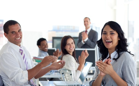 workplace: Businessteam applauding successful project Stock Photo