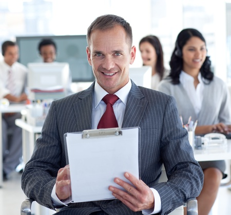 Male manager taking notes in a call center photo