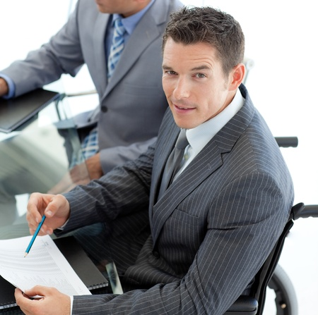 Close-up of a caucasian businessman in a wheelchair  photo