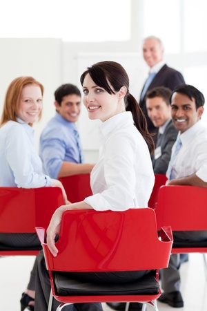 Attractive caucasian businesswoman at a conference photo