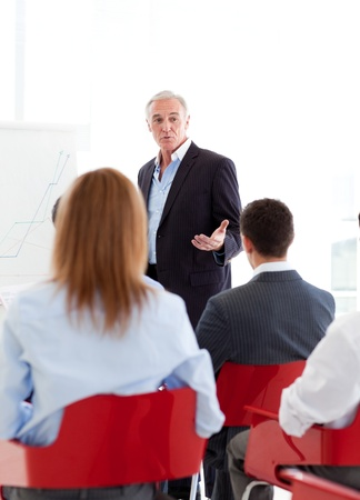 training consultant: Senior businessman giving a conference