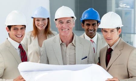 Architects with hardhats in a building site photo