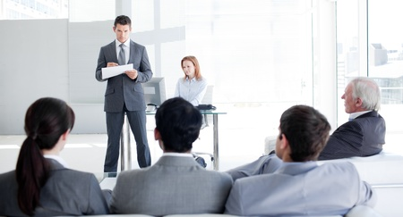 training consultant: A teamleader talking to his colleagues