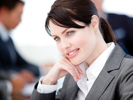 assertive: Assertive businesswoman in a meeting