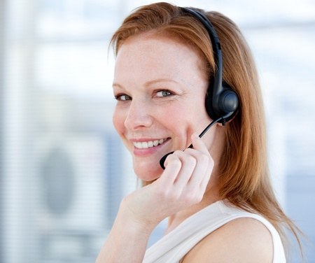Smiling sales representative woman with an headset photo