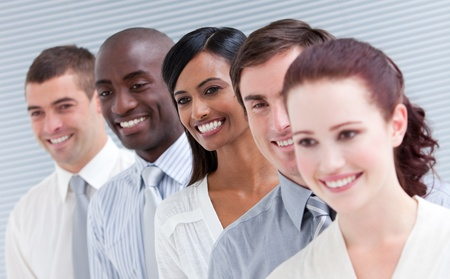 Multi-ethnic young business team standing in a row Stock Photo - 10250293