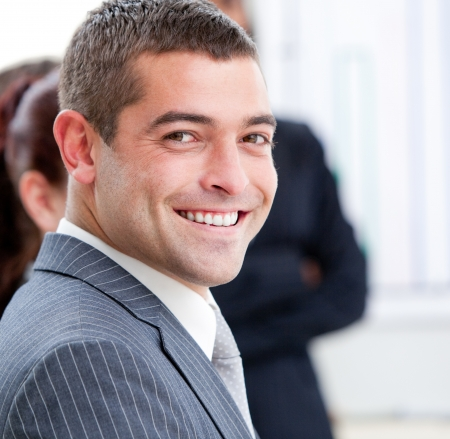 Close-up of a smiling businessman at a presentation photo