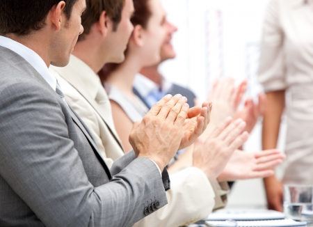 training consultant: Portrait of a businessteam applauding during a meeting Stock Photo