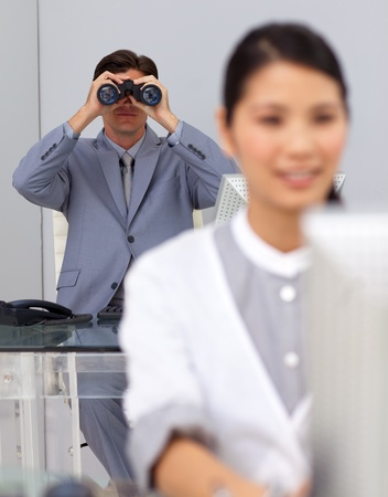 Visionary businessman using binoculars  photo