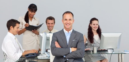 Concentrated Business partners working with their manager Stock Photo - 10247390