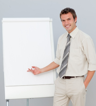 sales meeting: Attractive businessman reporting to sales figures Stock Photo