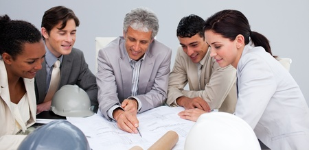 Constructors in a meeting studying plans photo