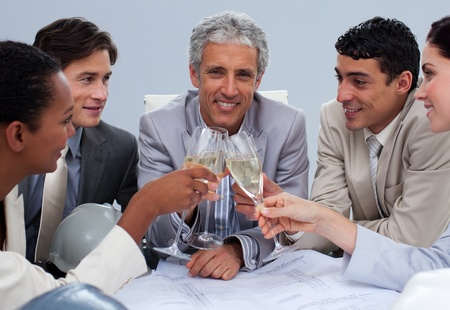 Happy engineer team celebrating a success with champagne Stock Photo - 10245955
