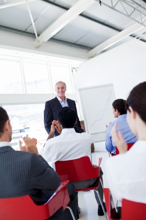 Business people applauding the speaker after the conference Stock Photo - 10246607