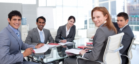 Business group showing ethnic diversity smiling at the camera photo