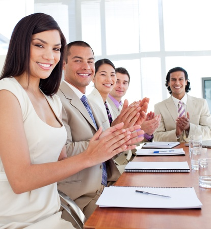Multi-ethnic business team applauding after a conference photo