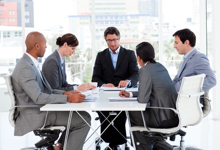 discussion group: A diverse business group disscussing a budget plan Stock Photo