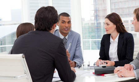 group discussions: Ambitious business group having a meeting Stock Photo