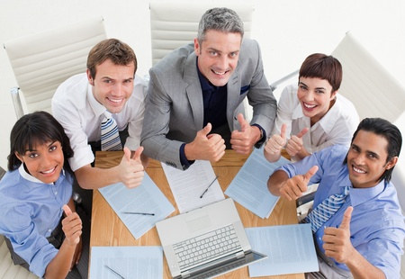 High angle of a cheerful business team with thumbs up photo