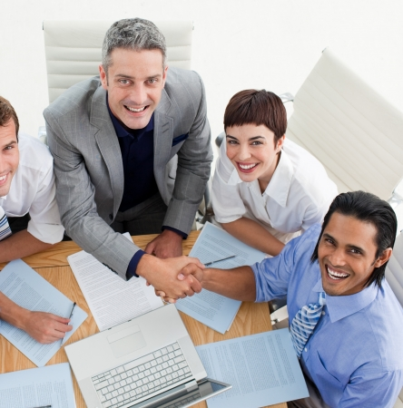 Two smiling business people greeting each other Stock Photo - 10233808