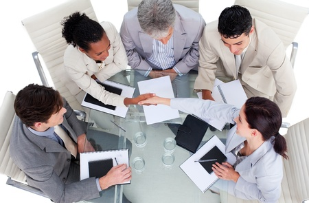 Cute multi-ethnic business team closing a deal Stock Photo - 10248140