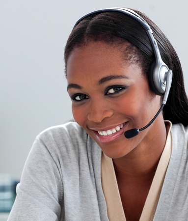 Delighted Afro-american businesswoman using headset Stock Photo - 10233944