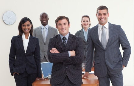 to deal with: Confident business team looking at the camera