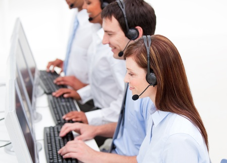 international sales: Serious customer service agents at work Stock Photo