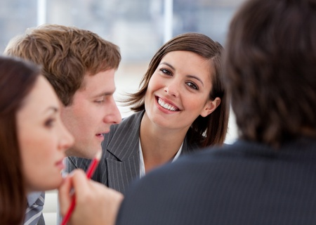 teaming: Portrait of an assertive businesswoman and her team