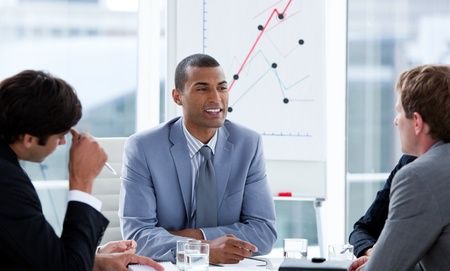 teaming: Successful businessmen having a brainstorming