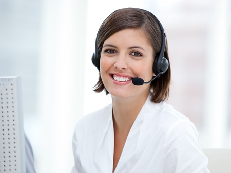 telemarketer: Portrait of a pretty customer agent at work