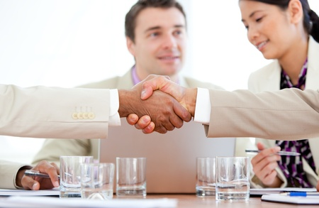Close-up of two business people greeting each other photo
