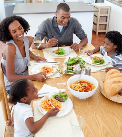 dinner table: Smiling family dining together Stock Photo