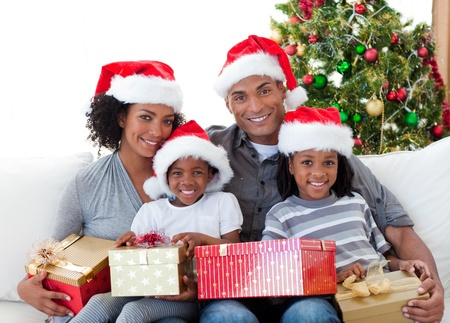family living: Afro-American family holding Christmas presents Stock Photo