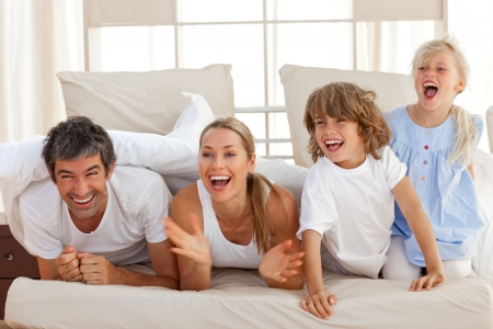 Laughing parents playing with their children Stock Photo - 10248146