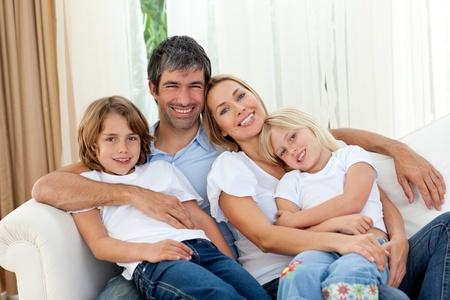 Loving family looking a tthe camera photo