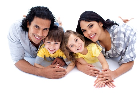 Lively family lying on the floor photo